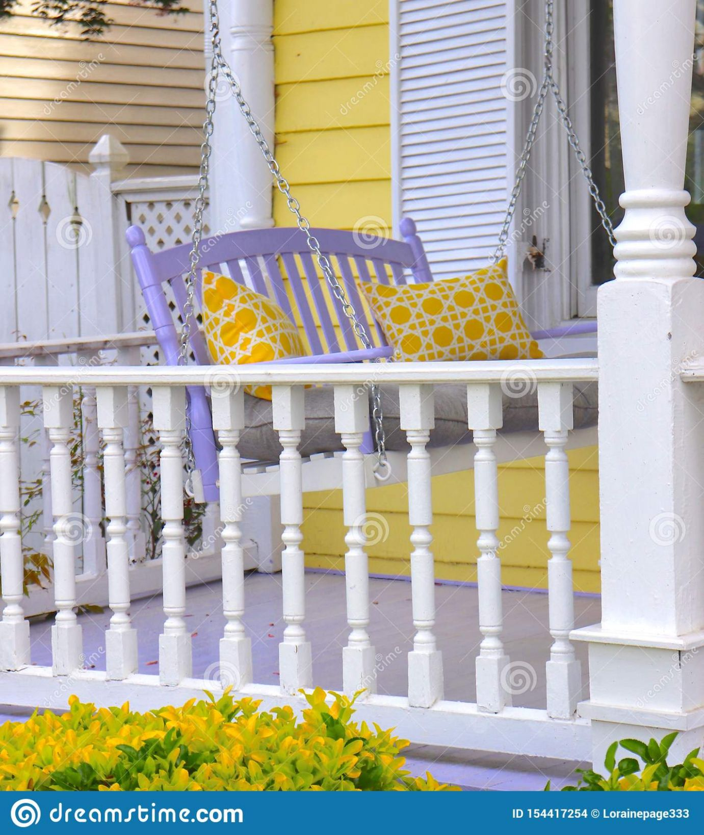 Porch Decor With Lavender Swing And Yellow Pillows Stock Photo ..