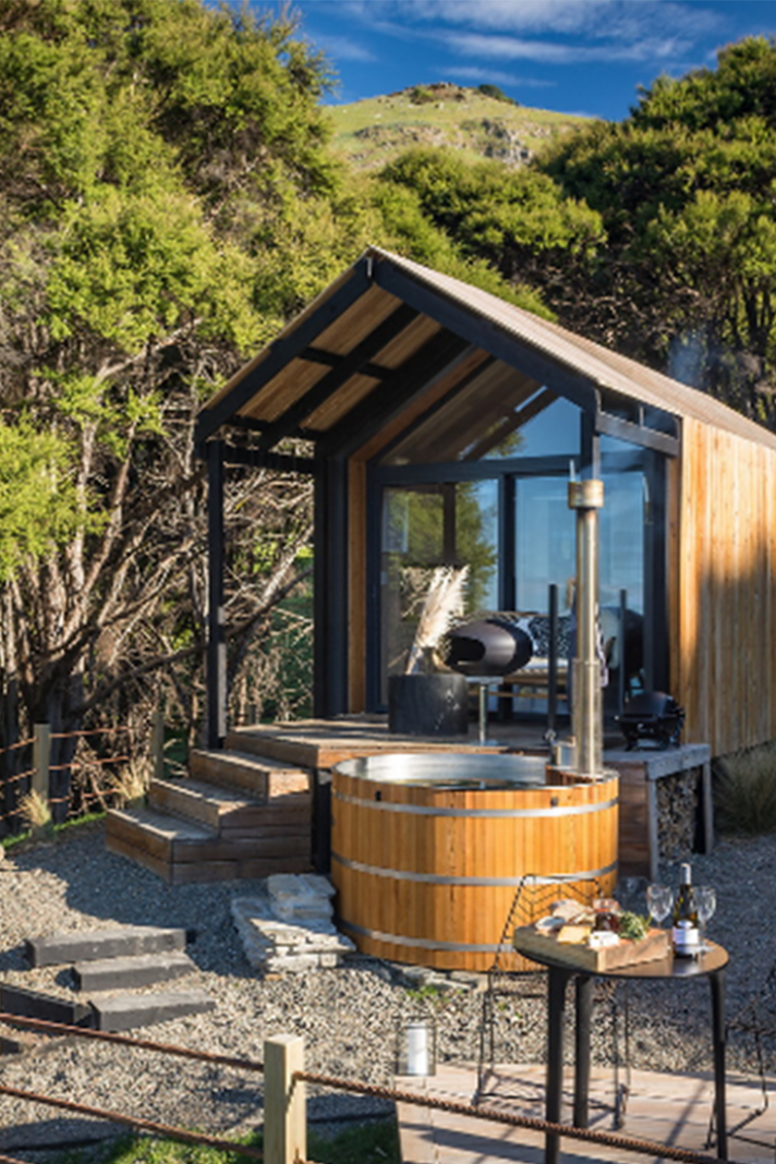 Remote tiny house rental is nestled in native bush with sea views ..