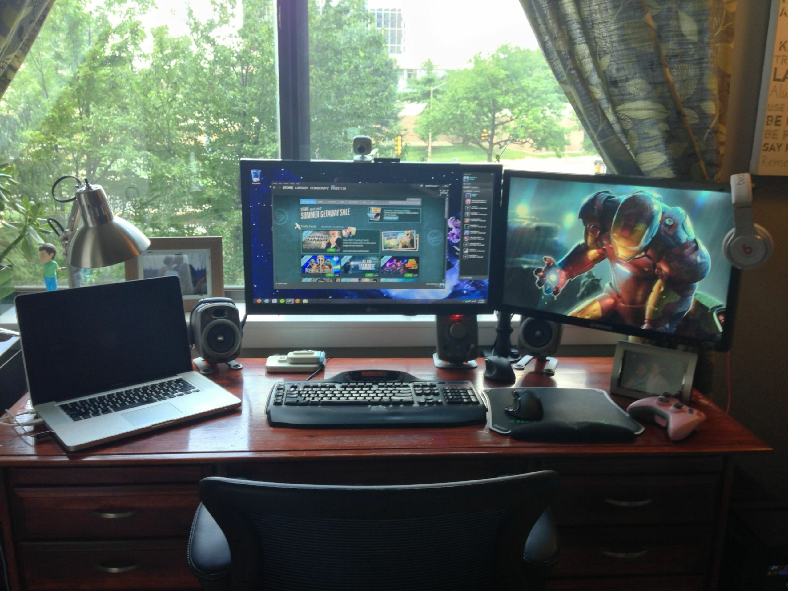 Revised setup using a dual monitor stand to regain desktop space ..