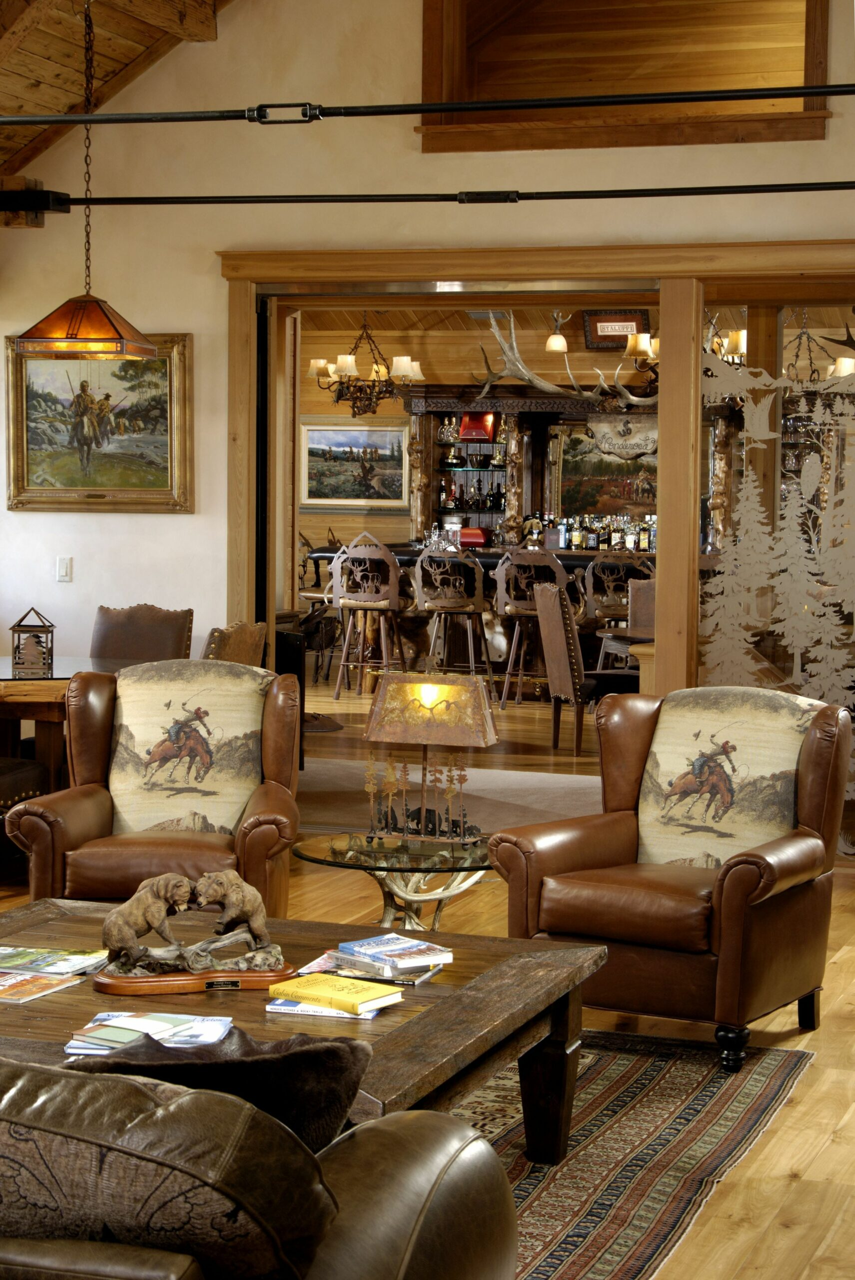 Rustic western ranch home... love the cowboy chairs and the antler ..