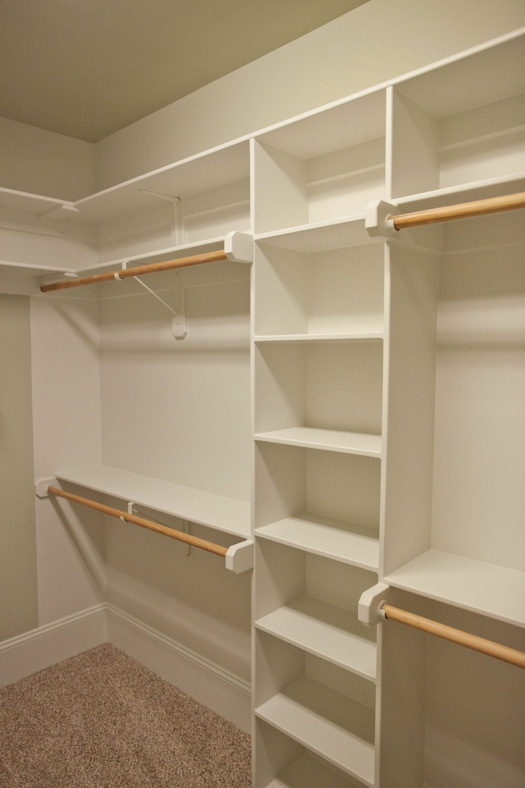 Spacious closet with built in shelves and two levels of hanging ..