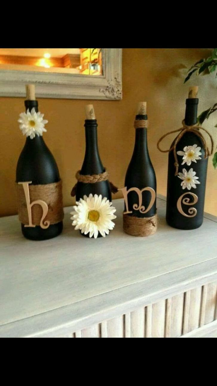 Super cute DIY idea. Wine bottles, spray paint, twine and letters ...