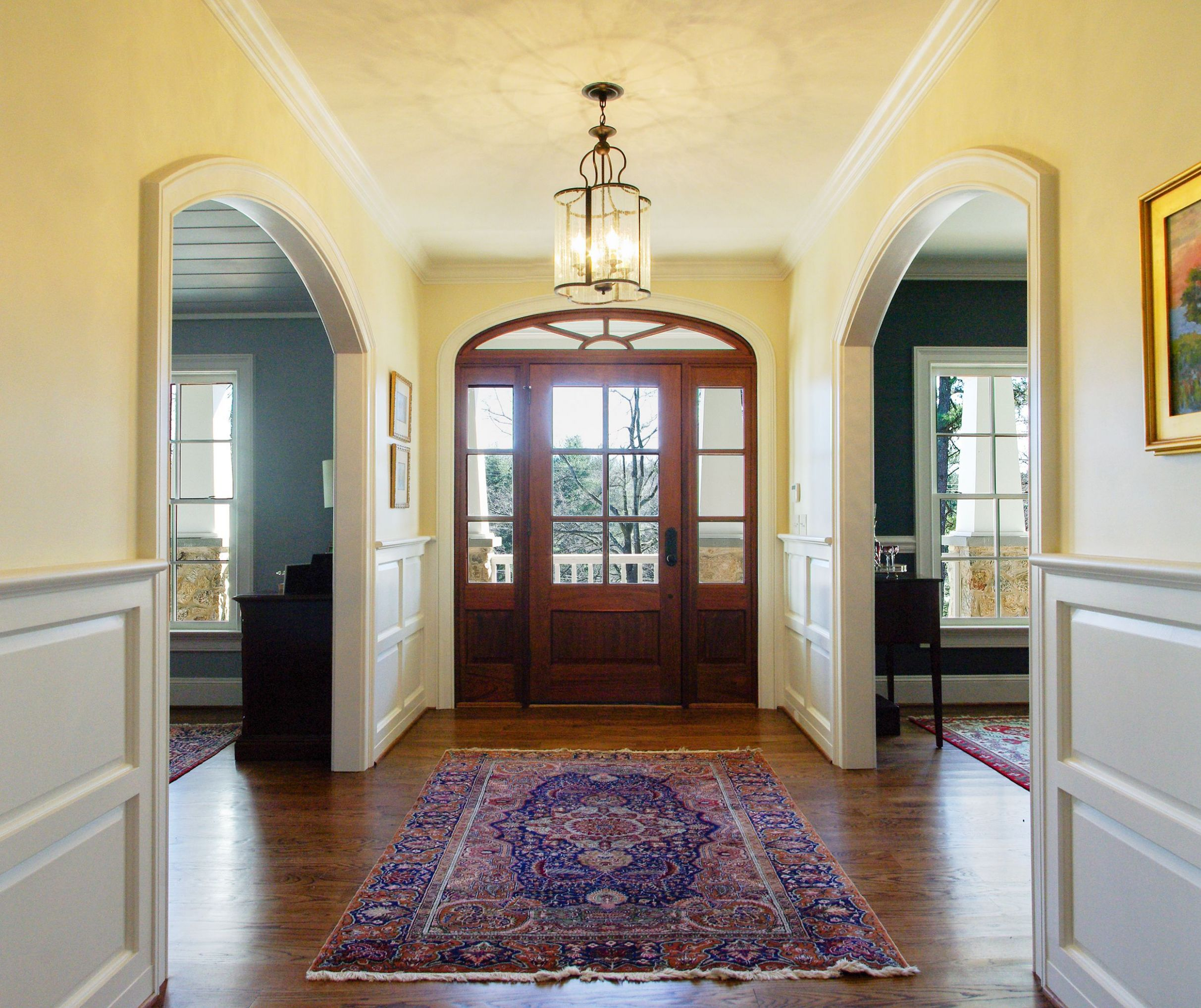This new entry foyer is flanked by arched openings to the dining ..