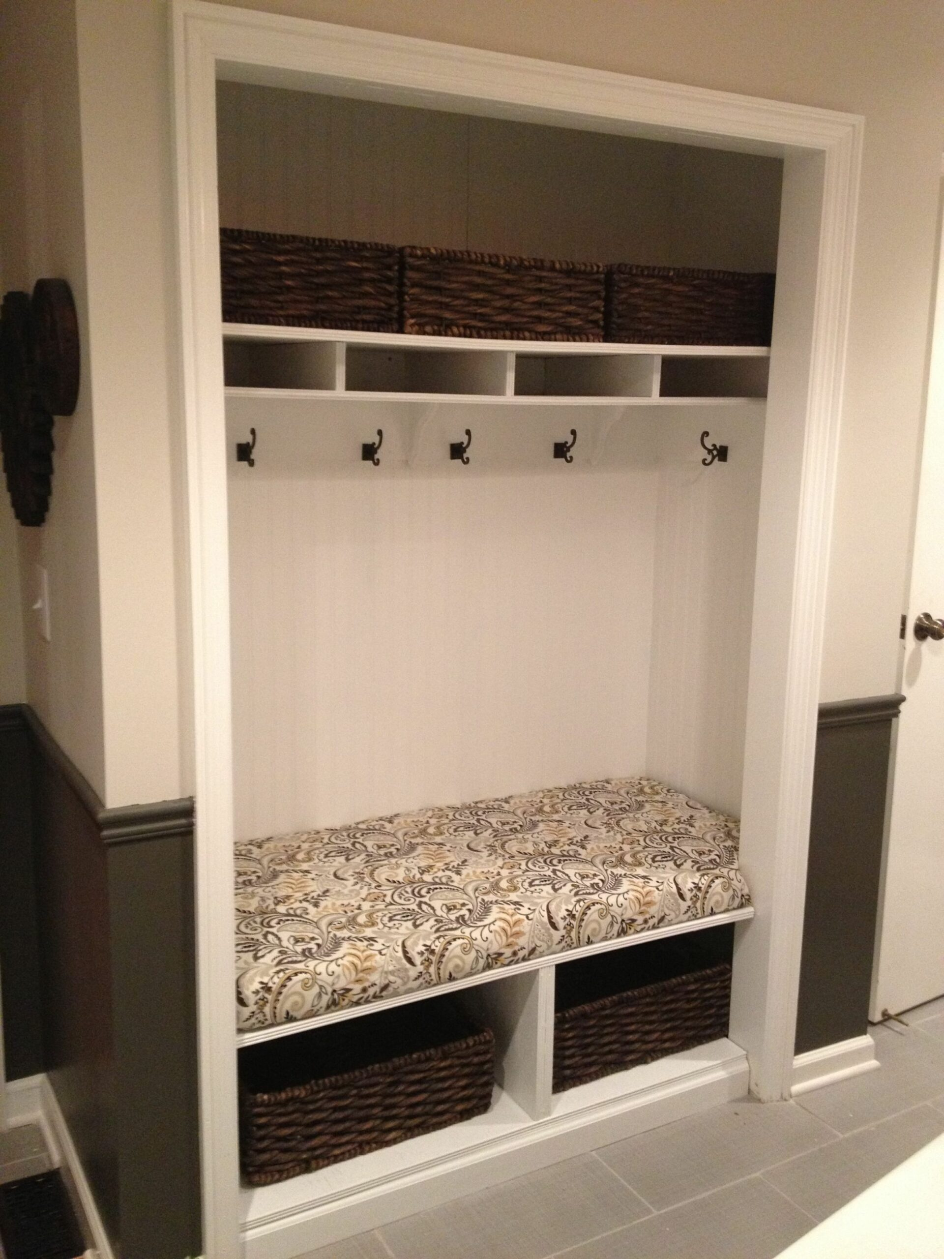 unused mudroom closet converted into a bench with hooks and ..