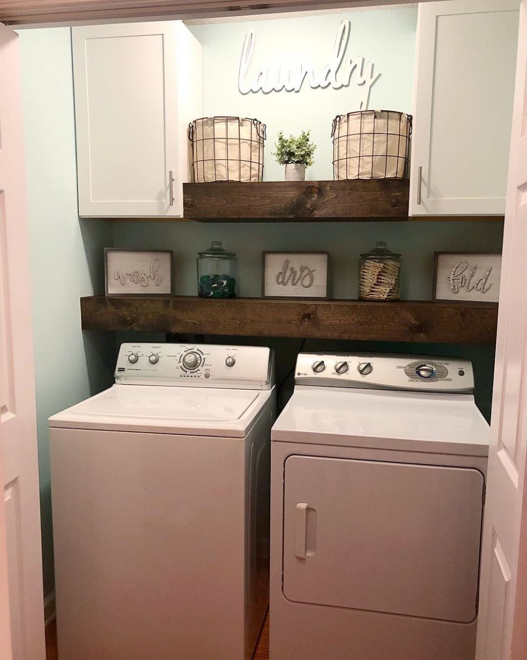 With curtain rod for hanging shirts (With images) | Laundry room diy - laundry room ideas in garage