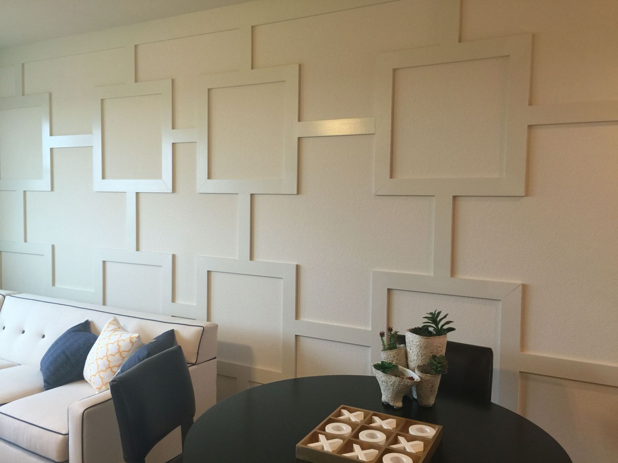 Wood trim design accent wall. Simply use 11x11's to add this look to ...