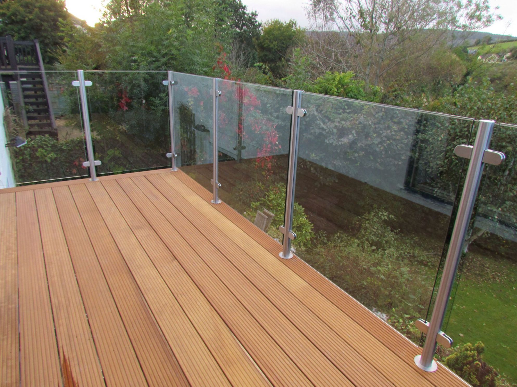 Wooden deck with glass balustrade | Glass balcony, Glass railing ..